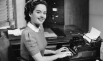 black and white image of female secretary with typewriter